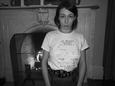 CAMILLE BIDAULT WADDINGTON in the T-shirt designed by her French lover using the receipt of their first date at Le Select in Paris