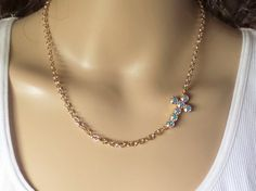 swarovski crystal cross, necklace,crystal,,sideways, aroura borealis, petite,meaning, faith. dksjewelrydesigns