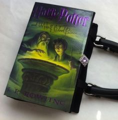 I love these purses made from hardback books! Harry Potter is just one of them. She has lots of Jane Austen purses, and other classics. So cool. I want them all.