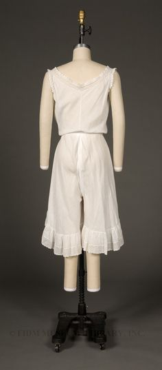 combination undergarment (back) -  Women used combinations for their advantage when they were made in this period. It was less bulky under their dresses than the previous chemise and undergarments