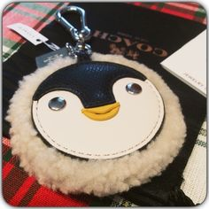Coach Keychain Penguin❤️ So Cozy! And Soft. New with tags Coach Penguin Keychain. Comes with Black Coach Dust Bag and Coach Bag. Coach Accessories Key & Card Holders