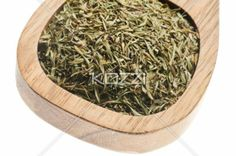 dry green tea leaves - Dry green tea leaves on a wooden spoon