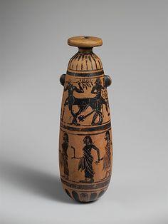 Terracotta alabastron (perfume vase)    Period:      Archaic  Date:      6th century B.C.  Culture:      Etruscan  Medium:      Terracotta  Dimensions:      H. 7 1/8 in. (18.1 cm)  Classification:      Vases