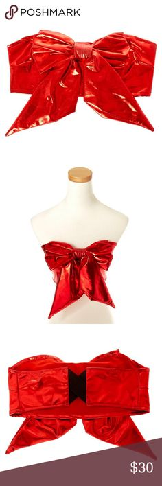 Metallic red bow tube top Rock around dressed like a pretty present wrapped up in a bright red bow! This Metallic Red Bow Tube Top is perfect for pairing with a fun Valentines colored tutu, some festive leggings, and more.  Metallic red color Large red bow embellishment Elastic cross stretch back Other