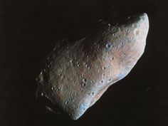 October 29, 1991: The Galileo spacecraft made its closest approach to asteroid 951 Gaspra, taking this photograph (enhanced with false color). | Photo credit: NASA