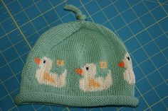 Oregon Ducklings In A Row Baby Hat by Lorna Pearman. Pattern for purchase at Ravelry