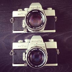 Twin Minolta's...I have my dad's old camera like this!!!