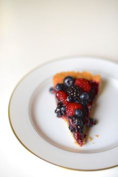 triple berry pie - fresh fruit sitting on a puree-slathered crust