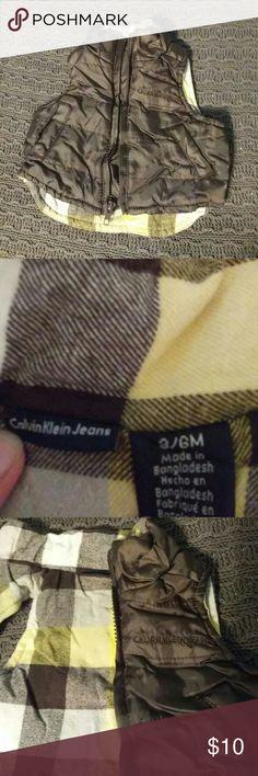 Calvin Klein Jeans 3-6M Vest Calvin Klein Jeans 3-6M Vest perfect for Spring! Adorable checker design inside, pockets on each side of vest, EUC! Dress your little one in designer!  All offers considered! Bundle to save! Calvin Klein Jeans Jackets & Coats Vests