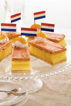 A tompoes or tompouce (lit. Tom Cat or Tom Thumb) is a common pastry in the Netherlands and Belgium. It is the local variety of the mille-feuille or Napoleon.