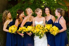 blue and yellow wedding - navy dresses and all yellow bouquets