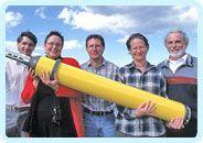 CSIRO scientists holding a robotic Argo float.