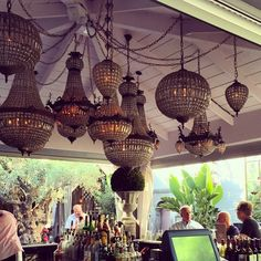 Chandelier cluster at garden bar at Pump Restaurant by Lisa Vanderpump West Hollywood. Photo by Isharya.