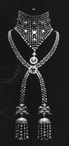 """Cartier diamond necklace with latticework and tassels. Ordered by Caroline Otero in 1903. the stunning diamond résille with bow tassel stomacher in circular- and rose-cut diamonds. Commissioned in 1903 by la Belle Otéro and mounted with the stones of her famous boléro, from Cartier. The long stripes with tassels and bows, are looking like the famous necklace of the french """" l'affaire du collier de la reine """" Queen Marie-Antoinettes."""