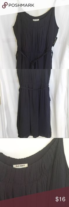 NWT Old Navy -Navy Blue Dress w Sash This darling and flirty dress is great for all seasons! Pair with a jacket and ankle boots or with a belt and heels, this is a very versatile dress! 100% Rayon, hand wash/line dry, knee length. Old Navy Dresses Midi