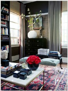 Darker hued sitting area with pale blue poofs