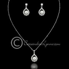 Simple off-whitewhite pearls in a round drop CZ setting. Earrings are approximately 1 inch, post back, necklace is 16 inches with a lobster claw clasp. Rhodium plated, grade AAA cubic zirconia, glass