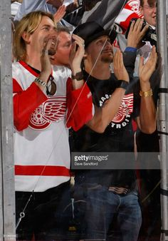Musicians Chad Kroeger of Nickelback and Kid Rock attend game five of the 2008 NHL Stanley Cup Finals between the Detroit Red Wings and the Pittsburgh Penguins at Joe Louis Arena on June 2, 2008 in Detroit, Michigan. (Photo credit: Dave Sandford)