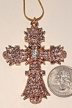 "Large size highly polished costume jewelry cross with center clear rhinestone. The 18"" chain is marked 18k gold plated.  The cross measures 2.1/2 inches long and 2 inches wide."