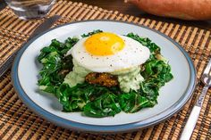 Chipotle Sweet Potato and Black Bean Quinoa Cakes with Creamy Avocado Sauce and a Fried Egg