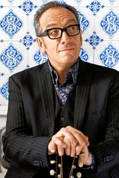 How Elvis Costello Created 'Red Shoes' Before he became a recording artist, Elvis Costello wrote 'Red Shoes' on a train to Liverpool in 1976.  Elvis Costello discusses writing the song and recording his first album.