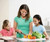 parents cooking healthy recipes for family