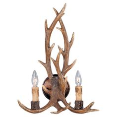 Wall sconce with weathered antler-inspired detail.   Product: Wall sconceConstruction Material: Resin and metal
