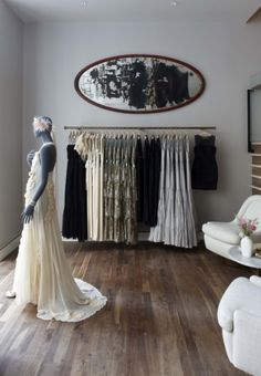 A slate-gray mannequin faces a storefront window at the BHLDN boutique in Chicago. Subdued materials, including simple walnut flooring, highlight the brand's romantic, vintage-inspired gowns and accessories. Photography: Derek Henderson and Samuel Nixon, Sydney, Australia