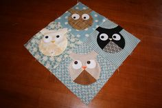 A quilt I must make.         Here's a tutorial: http://tulip-patch.blogspot.com/2011/08/gobaby-tutorial-roly-poly-owl-block.html