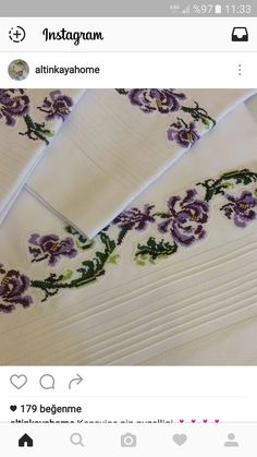 Embroidered violets on white linen..