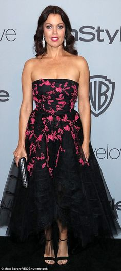 Flower power:Bellamy Young andConstance Wu opted for black frocks with floral designs...