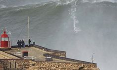 "Surfing the world's biggest wave by Garrett McNamara is one of ""2013: Eyewitness accounts"" for the British newspaper The Guardian  Born to ride: Garrett McNamara surfing a giant wave in Nazaré. Portugal. Photograph: Tó Mané"