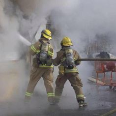 They are heroes because they are helping put out a fire and probably saving someones life.