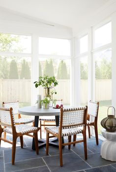 2e2e4cfab69 A cozy dining nook in a newly updated screened porch located in Chevy  Chase