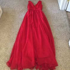 """Red Prom Dress Beautiful flowing soft dress. Fully lined. Worn once by my daughter. She's 5'7"""" dress fits perfect length wise with few inch heels. May need to dry clean bottom a little dirty but can't see unless you really look. Dresses Maxi"""