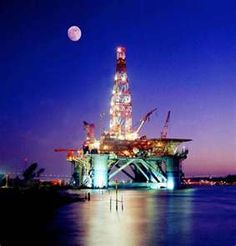 Offshore drilling platform at night.