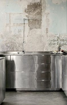 stainless steel cabinets, concrete walls & floor kitchen