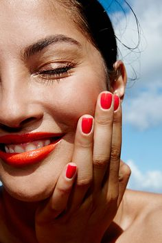 Bright nails, bright lips, dusty gold eyelids.