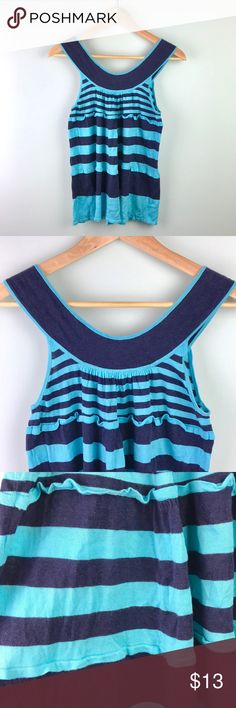 """Free People Tank Top Pretty chunky striped fashion tank top by Free People, size small petite. Navy and aqua blue. Cute bunching along scoop neckline. 2 rows of layered ruffles along top and midsection of shirt. Previously had a small tear under left armpit but was professionally fixed by a seamstress (as pictured). Not noticeable since under arm and repaired but wanted to be honest. Great condition with a ton of wear left! 14"""" bust, 19"""" long. Super soft!  ✅Fast ship! ✅Pet and smoke free…"""