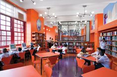 This school library in PS 69 in the Bronx is bright with lots of natural light and vivid colors throughout. The tables in the center are great for group work and the computers along the windows can be used during instruction or as individual work spaces.