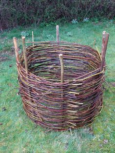 Potato towers. Made from willow branches. Four main posts in square are tied together at the top. Then willow hoops are stacked in between posts to keep dirt in. To open the potato tower, all we have to do is undo the ties at the top, pull posts out of ground and let the willow hoops unfold, exposing the dirt tower remaining. Tarp with square hole can be placed at the foot before opening.