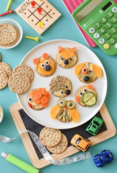 Animal Cracker Snackables - Fork and Beans - Make an after school snack FUN by taking Simple Mills crackers and turning them into a work of art - Owl Snacks, Cute Kids Snacks, Animal Snacks, Toddler Snacks, Healthy Snacks For Kids, Toddler Toys, Baby Toys, Animal Crackers, Food Art For Kids