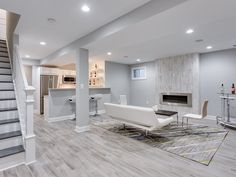 Turning an unfinished basement into extra living space? Learn what to do when finishing basement walls to achieve quality, comfortable conditions. Gray Basement, Basement Paint Colors, Basement Painting, Basement Living Rooms, Modern Basement, Basement Flooring, Grey Flooring, Flooring Ideas, Basement Bathroom