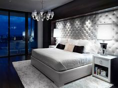 SO WANT THIS...  interesting idea... instead of a headboard just upholster the wall