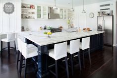 This stunning island bench surrounded with stools provides a meeting place for family and friends. Photo by Home Beautiful Kitchen Interior, Kitchen Design, Kitchen Ideas, Open Shelving, Shelves, Modern House Plans, Inspired Homes, Island Bench, Big Island