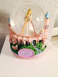 Barbie As Rapunzel Musical Snow Globe Barbie http://www.amazon.com/dp/B001K2529G/ref=cm_sw_r_pi_dp_A2Qyub0SWPSY7