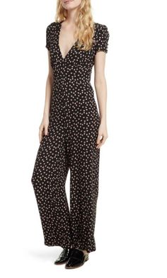 13cf66153a4 Size 10 Free People wide-legged jumpsuit with peach print.