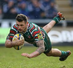 Leicester's Adam Thompstone dives over for a try
