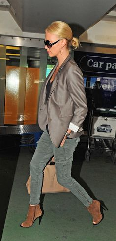 Charlize Theron | Green jeans + brown booties + metal blazer #street-style #fashion +#accessories