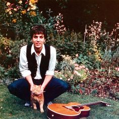 The great Syd Barrett (founder of Pink Floyd) with his cat and guitar about 1966